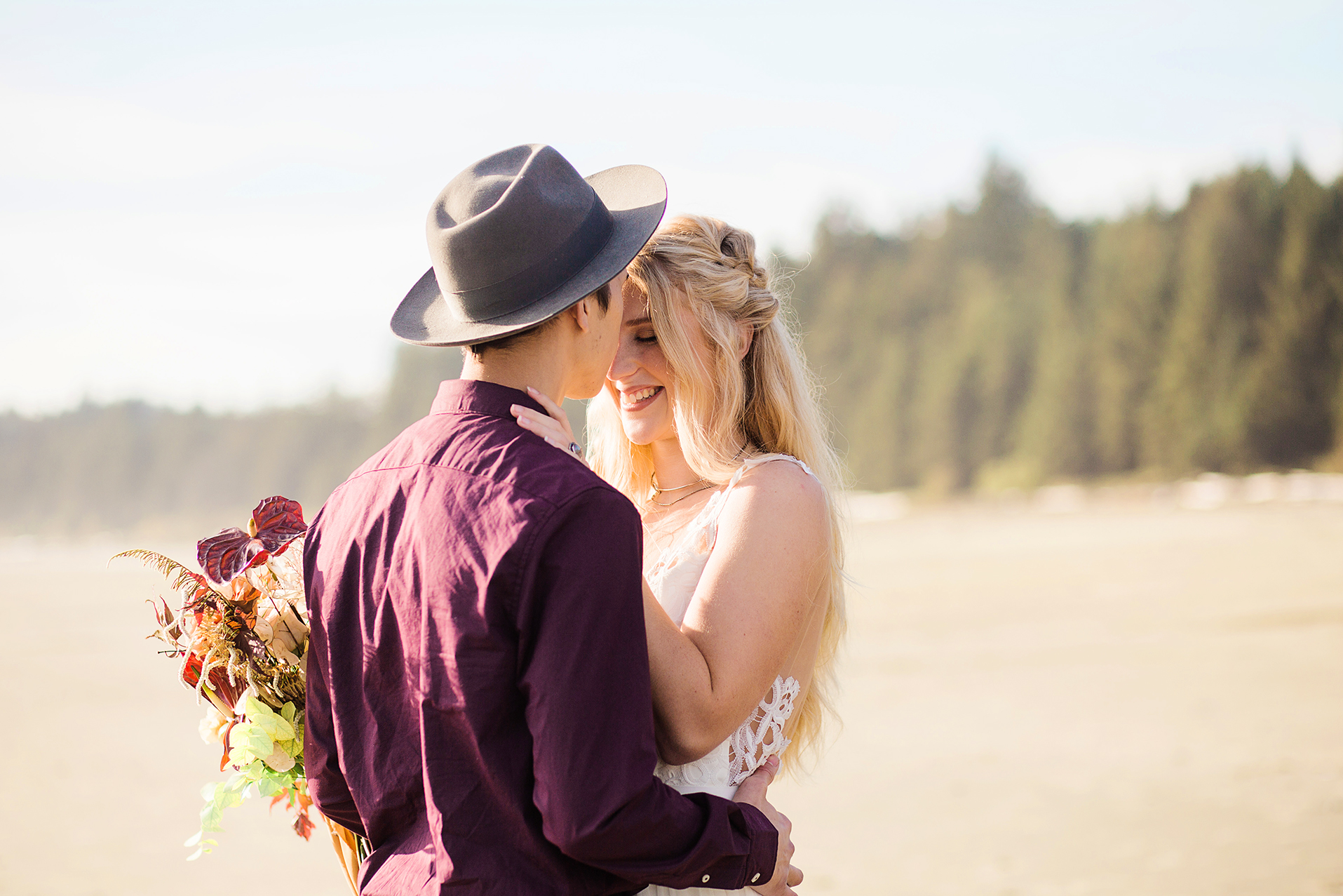 Couples lovin on a beach in Tofino - Saskatoon SK based Photographer